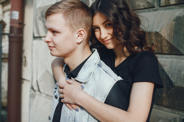 Young couple wallking in a old city