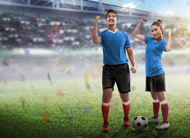 Young couple wearing football jersey