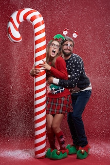 Young couple in weird christmas clothes