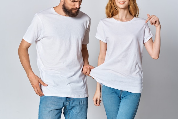 Young couple in white tshirts and jeans design mockup copy space
