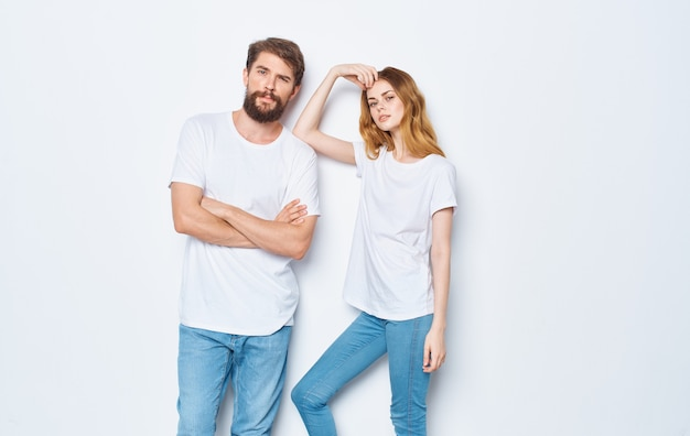 Young couple in white tshirts and jeans friendship on emotions mockup