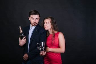 Young couple with champagne at party