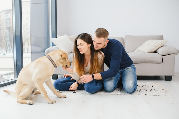 Young couple with a dog at home