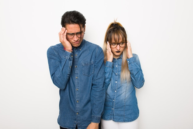 Young couple with glasses unhappy and frustrated with something