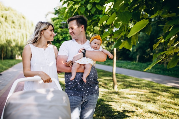 Young couple with their baby daughter in park