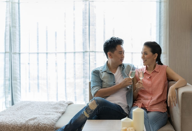 Young couples celebrate wine