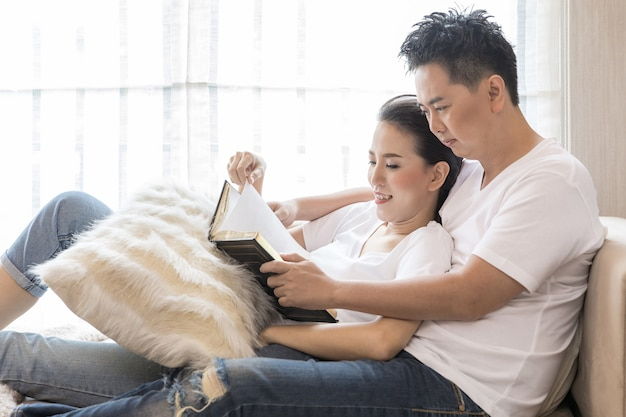 Young couples reading book