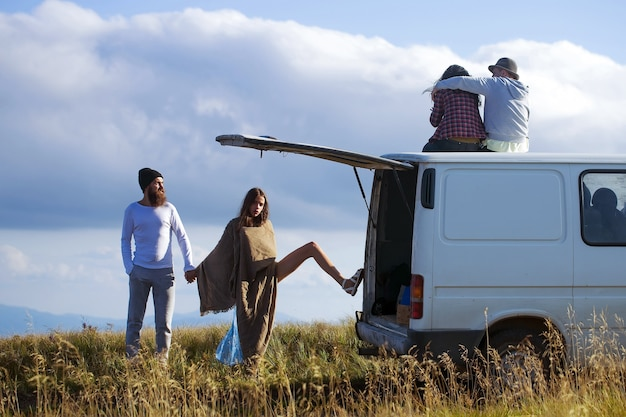 Young couples travel by minibus