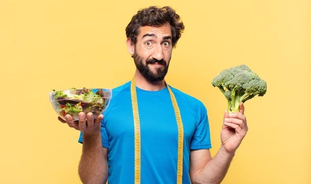 若い狂気のひげを生やしたアスリートは、表現と食事療法の概念を疑っているまたは不確かです