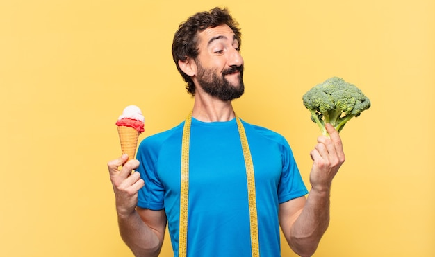 Young crazy bearded athlete happy expression and diet concept