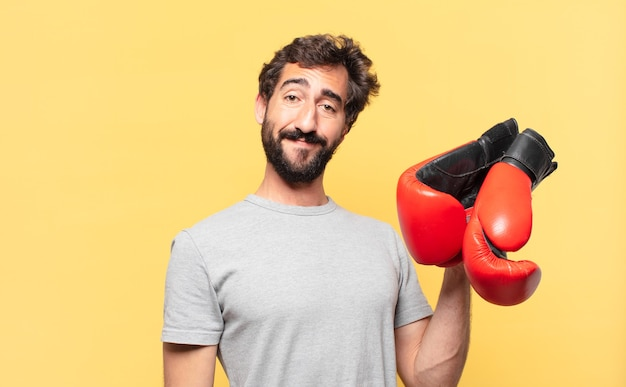 Young crazy bearded athlete happy expression and holding a boxing gloves