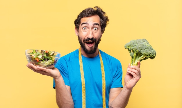 Young crazy bearded athlete surprised expression and diet concept