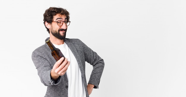 Young crazy bearded businessman having a beer