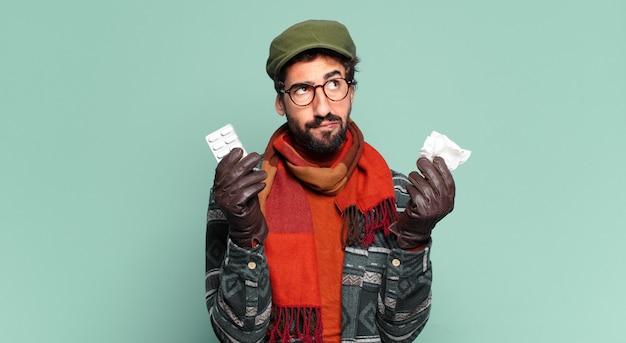 젊은 미친 수염 난 남자와 겨울 옷을 입고. 질병 개념