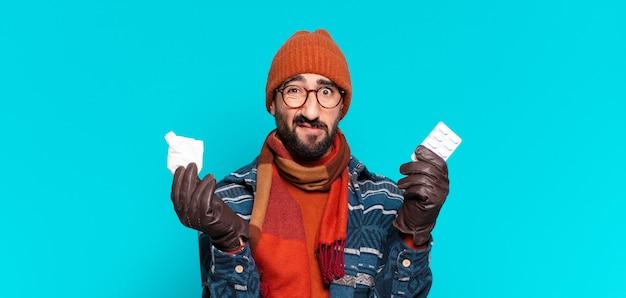 젊은 미친 수염 남자와 겨울 옷을 입고. 질병 개념