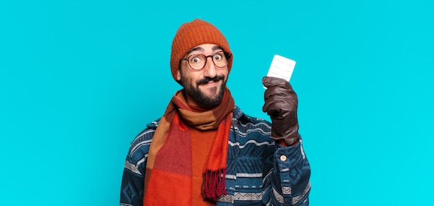 Young crazy bearded man. happy and surprised expression and wearing winter clothes. illness concept