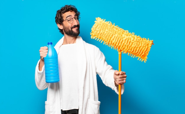 Young crazy bearded man housekeeper