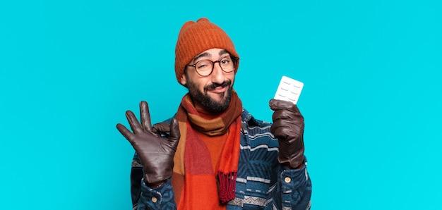 若い狂気のひげを生やした男の誇らしげな表情と冬服を着ています。病気の概念