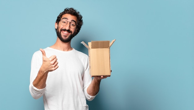 Young crazy bearded man recibing a cardboard package