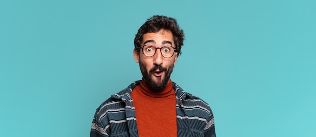 Young crazy bearded man. shocked or surprised expression