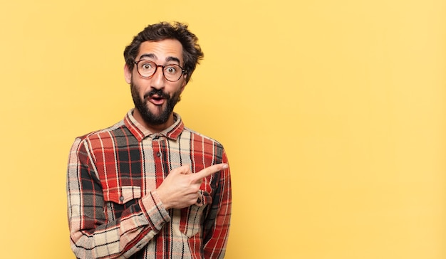 Young crazy bearded man surprised expression