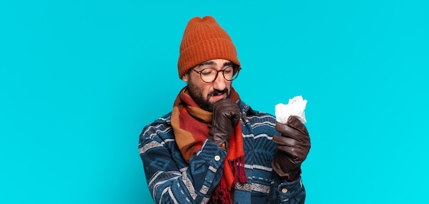 Young crazy bearded man and wearing winter clothes. illness concept