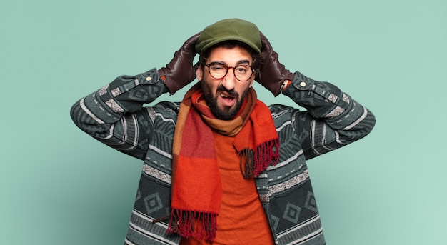 Young crazy bearded man and wearing winter clothes