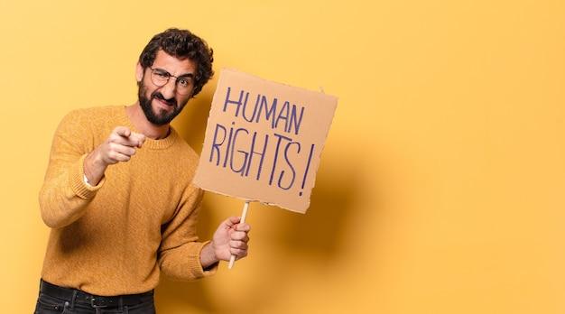 人権バナーを持つ若い狂ったひげを生やした男。