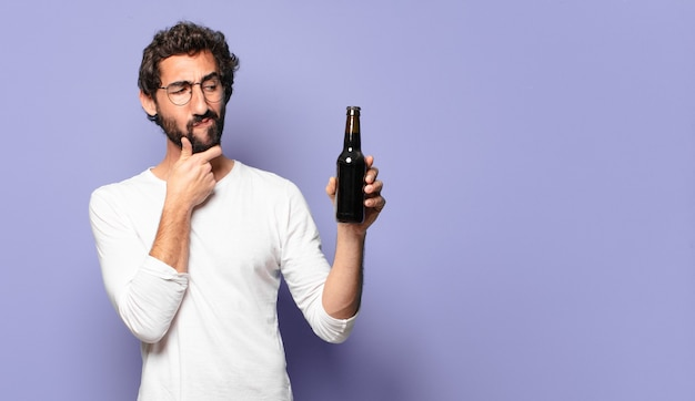 Young crazy bearded man with a beer