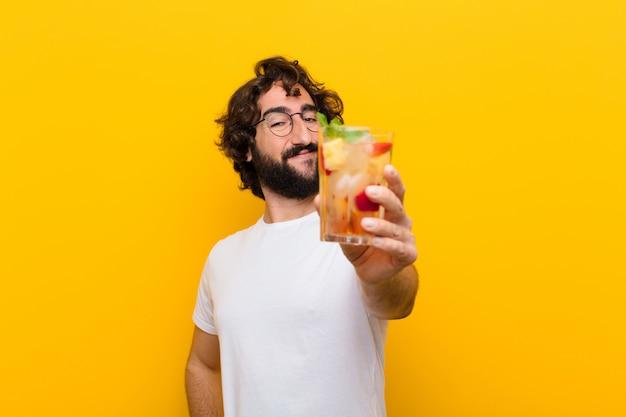 Young crazy bearded man with a cocktail. tourist