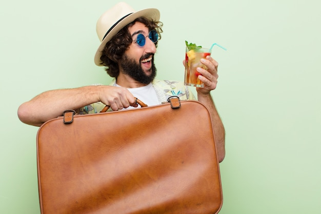 Young crazy bearded man with a cocktail. travel concept