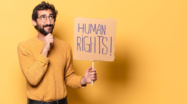 Young crazy bearded man with a human rights banner.