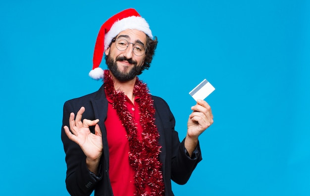 Young crazy bearded man with santa hat. christmas concept