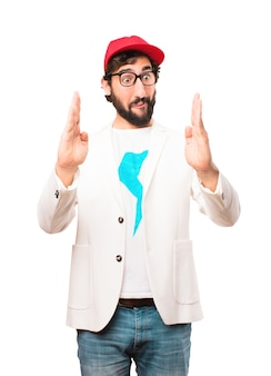 Young crazy businessman showing sign
