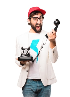 Young crazy businessman with vintage phone