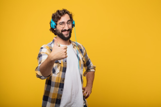 Young crazy mad man  fool pose listening music with a headphones