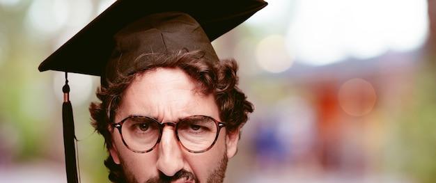 Young crazy man face. close up