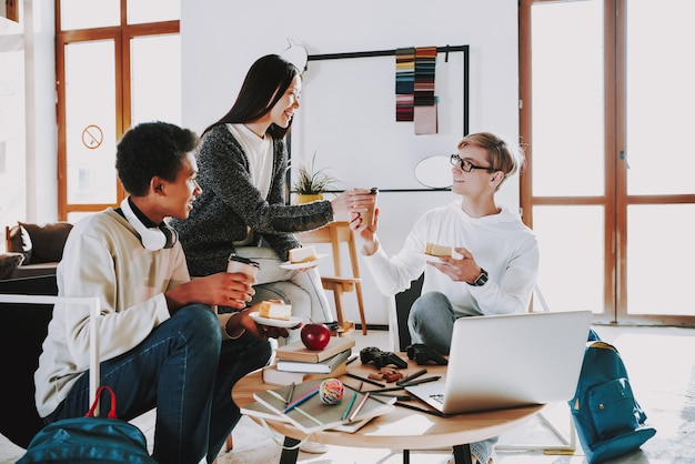 Young creators drink coffee in coworking place