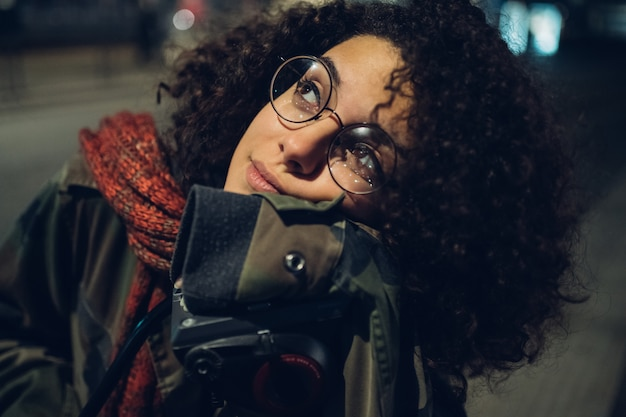 Young and curly girl looking ahead-