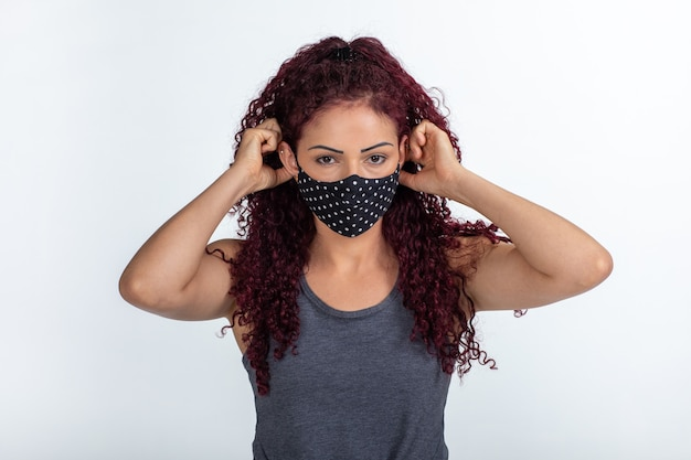 Young curly woman wearing a protective mask