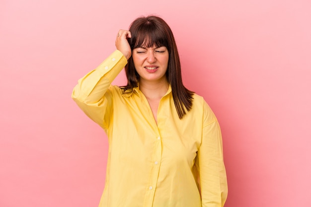 Young curvy caucasian woman isolated on pink background celebrating a victory, passion and enthusiasm, happy expression.