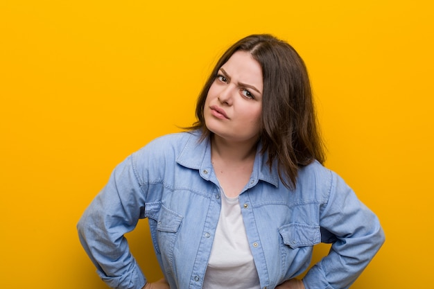 Young curvy plus size woman scolding someone very angry.
