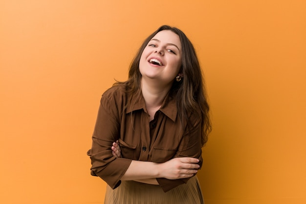 Young curvy russian woman laughing and having fun.