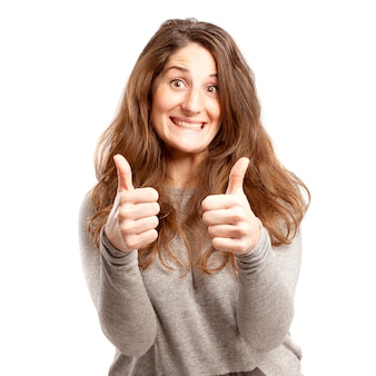 Young curvy woman with two thumbs up over white