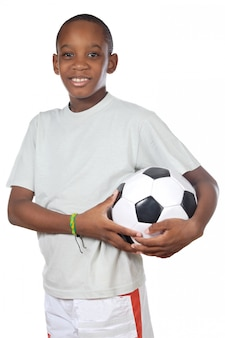 Young cute boy holding a soccer ball over white background
