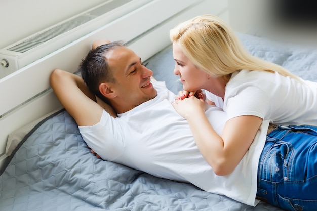 Young cute couple together in bed