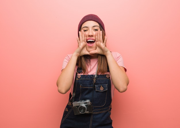 Young cute photographer woman shouting something happy to the front