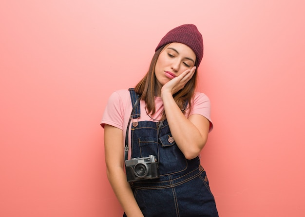Young cute photographer woman tired and very sleepy