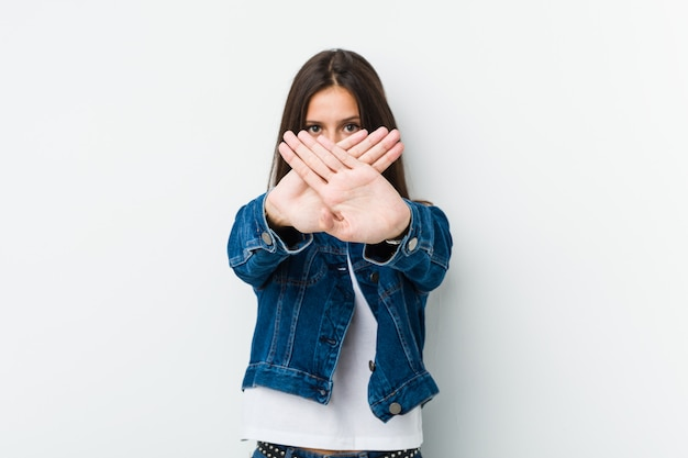Young cute woman doing a denial gesture