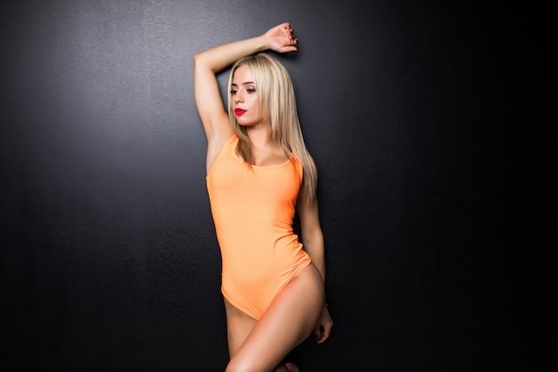 Young cute woman in gymnast suit